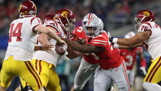 Ohio State Buckeyes defensive end Tyquan Lewis (59) rushes the passer during the game against the Southern California Trojans in the 2017 Cotton Bowl.