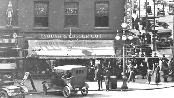 This photos is probably from about 1910.  The building seems to have been remodeled.  Punch has moved a little toward George Street and back to a ledge.