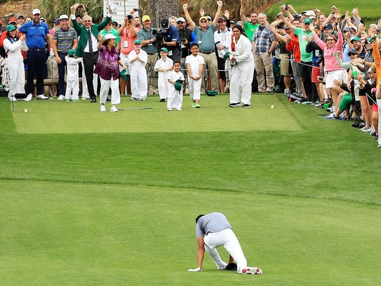 Tony Finau falls after rolling his ankle while celebrating