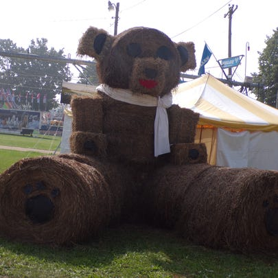 A large cuddly teddy bear greeted fair attendees as