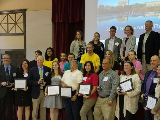 """The Somerset County Planning Board recently received recognition by the Sustainable Raritan River Initiative in the Government Innovation Category for the Somerset County Green Leadership Hub. """"We are very proud of our Planning Board for receiving this prestigious award, which is given to government entities whose actions protect the Raritan River and promote sustainability and resilience through actions and education,"""" said Freeholder Director Patricia Walsh, who championed the formation of the Hub in 2013. It is composed of subject-matter experts and experienced Planning Board staff.  She was instrumental in sharing with municipalities the benefits of their investments in sustainability initiatives. Pictured, Somerset County Planning Board Director Walter Lane and Principal Planner/Hub Coordinator Tara Kenyon (left-first row) joined other Sustainable Raritan River Initiative award winners at a recent recognition program.  The Sustainable Raritan River Initiative is a joint program of Rutgers Edward J. Bloustein School of Planning and Public Policy and the School of Environmental and Biological Science. It works with various stakeholders around the Raritan Basin and Bay to balance social, economic and environmental objectives toward the common goal of restoring the Raritan River, its tributaries and its estuary for current and future generations. To learn more about the Somerset County Planning Board, visit www.co.somerset.nj.us/government/public-works/planning."""