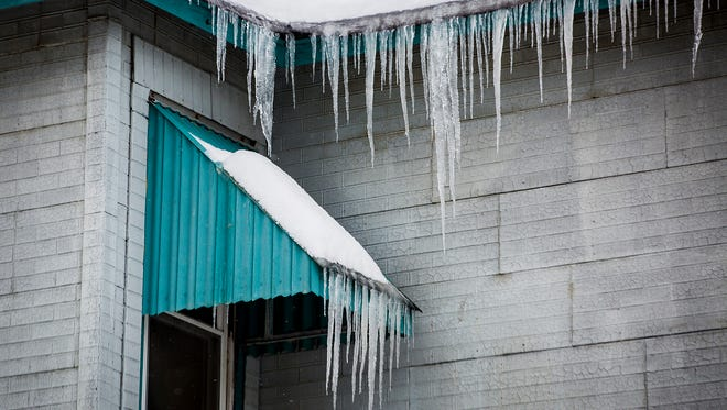 Icicles form on a home on the southside of Muncie.