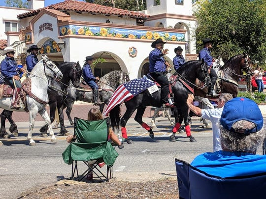The Fourth of July parade is an annual tradition in Ojai, with spectators lining the street in spots they've often staked out in advance.