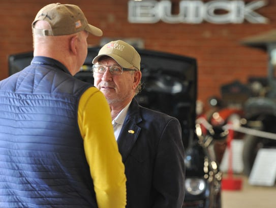 Harry Patterson, president of Patterson Auto Group, center, said he has been collecting cars for several years and thought it would be a good idea to open the collection up to the public.
