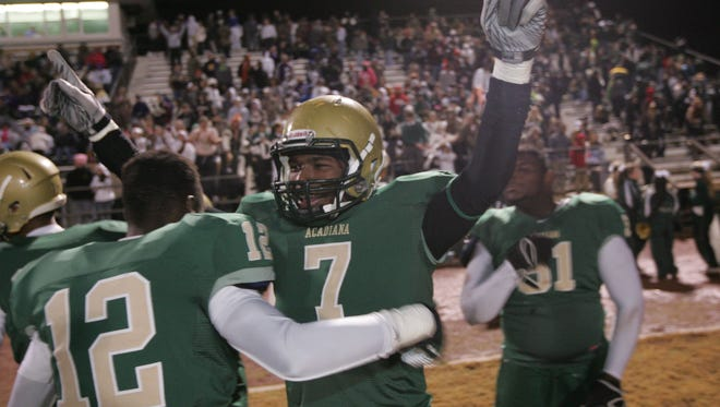 Acadiana High stars Kevin Moore and Javonte Edmond, shown celebrate a past playoff win, are hoping to be celebrating again Friday night at Parkway.