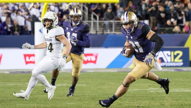Washington defensive back Taylor Rapp (right) intercepted two passes against Colorado in the  Pac-12 Championship, returning one for a touchdown.