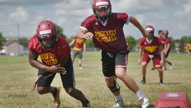 Roosevelt High School practices Friday, Aug. 11, at the high school football field in Sioux Falls.