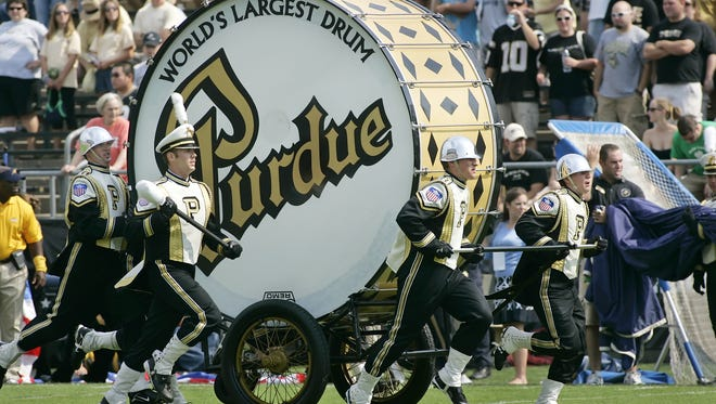 Members of the big bass drum crew perform with the Purdue All-American Marching Band at halftime of a game at Ross-Ade Stadium.