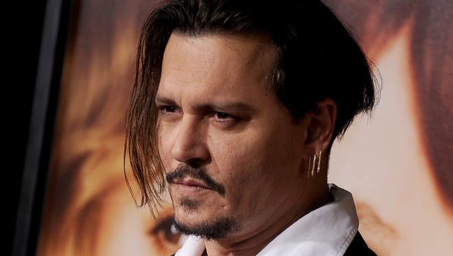 Johnny Depp arrives at the Nov. 21 premiere of 'The Danish Girl' at Westwood, California.