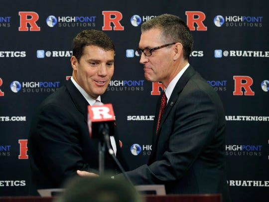 Rutgers football coach Chris Ash (left) impressed athletics director Pat Hobbs (right) with his plans for instilling player-mentoring programs.