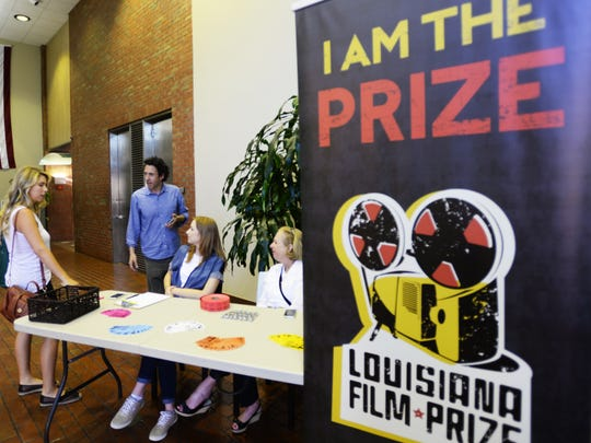 People from the Louisiana Film Prize wait in the lobby of the American Tower building for the final submissions of the films before the midnight deadline.