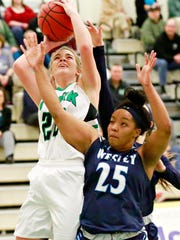York College's Katie McGowan, left, takes the ball to the basket while Wesley College's Chardae Booker-Hayes defends during women's basketball action in Grumbacher Sport and Fitness Center at York College of Pennsylvania in Spring Garden Township, Wednesday, Jan. 31, 2018. York College would win the game 83-48. Dawn J. Sagert photo