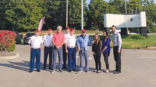"""Marine Corps League - Lake of the Ozarks Detachment awards the """"Grand Old Flag"""" to Patriots Bank on Horseshoe Bend Blvd for their display of a """"holiday"""" flag."""