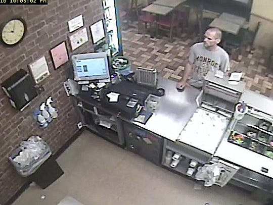 Security footage shows the suspect in a reported robbery