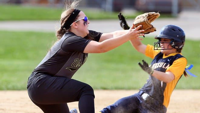 St. Ursula Academy's Maddie Hancock tried to steal second base and got tagged out by Ursuline Academy's Mailey Lorio.