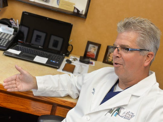Dr. Walter Ellis talks about the uses for, and the effectiveness of, Extracorporeal Pulse Activation Technology (EPAT) during an interview Wednesday, July 27, 2016, in his office at St. Cloud Foot & Ankle Center.