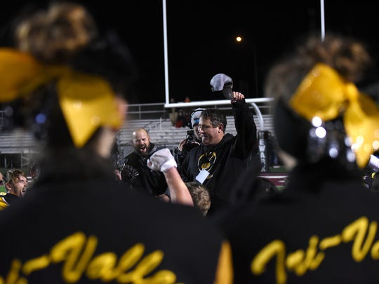 Tri-Valley head coach Justin Buttermore huddles with his team and coaching staff post game after defeating Bishop Hartley 13-9 in Friday night's regional final at White Field in Newark.