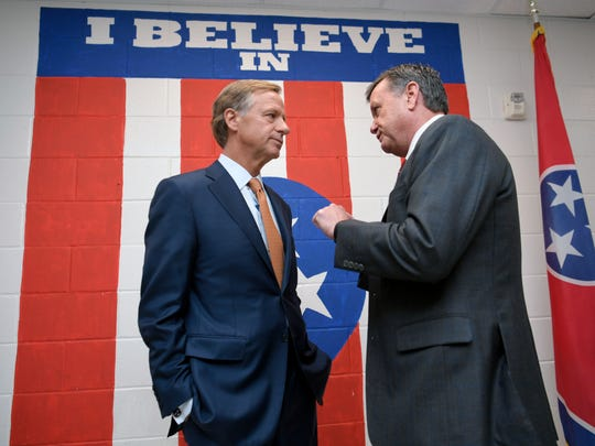 Franklin Special School District Director of Schools David Swonden talks with Gov. Bill Haslam during a visit to Freedom Intermediate School in Franklin, Tenn.