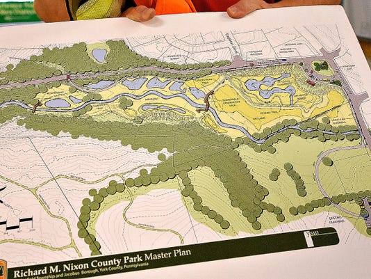Richard Nixon County Park Manager of Education and Outreach Francis Velazquez shows the color rendition of the master plans for the park, including the wetlands project which is underway, at the park in Springfield Township in York, Pa. on Wednesday, Sept. 2, 2015. Dawn J. Sagert - dsagert@yorkdispatch.com
