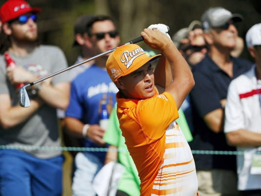 Rickie Fowler tees off on the third hole during the final round of the Deutsche Bank Championship in Norton, Mass., on Monday.