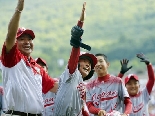 Japan's Koki Jo, center, waves to his team's parent section in the stands after he drove in the winning run in the international league championship game at the Little League World Series Saturday. Japan advances to the world championship game to play Red Land.