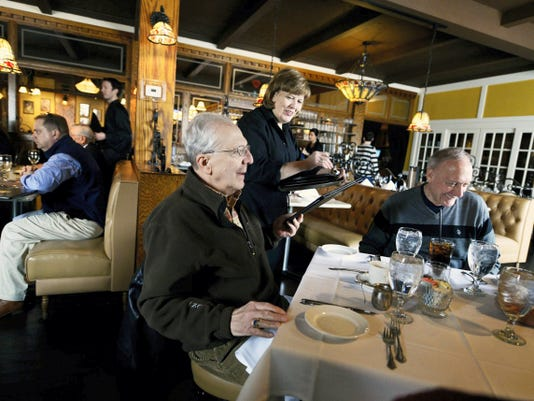 Server Lori Shull takes lunch order from Eddie Leeds, left, and Ben Slowik, both of Spring Garden Township, at Roosevelt Tavern in York Friday, March 13, 2015.   Kate Penn — Daily Record/Sunday News