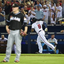 Justin Upton #8 of the Atlanta Braves rounds the bases after hitting a sixth inning two-run home run against Tom Koehler #34 of the Miami Marlins at Turner Field on August 29, 2014 in Atlanta.