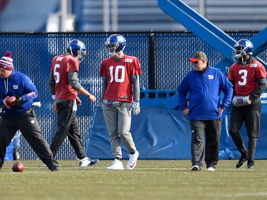 New York Giants quarterbacks Davis Webb (5), Eli Manning (10), and Geno Smith (3) during practice in East Rutherford, NJ on Wednesday, December 6, 2017.