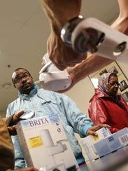 Home Depot workers teach Flint, Mich., residents how