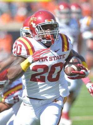 Iowa State Cyclones running back DeVondrick Nealy (20) carries the ball during the first half against the Oklahoma State Cowboys at Boone Pickens Stadium.