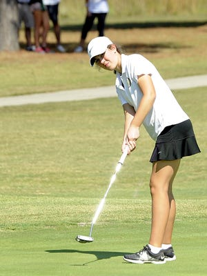 Central Magnet's Delaney Sain putts during Wednesday's Class A-AA State Golf Tournament.