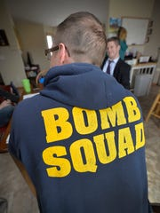 U.S. Air Force veteran Todd Kuikka wears his bomb squad