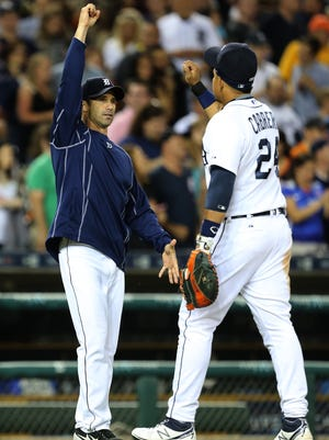 Detroit Tigers manager Brad Ausmus and Miguel Cabrera celebrate after the 5-4 win against the Chicago White Sox on Friday, June 26, 2015 at Comerica Park in Detroit.