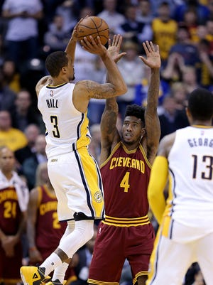 Indiana Pacers guard George Hill (3) attempts a shot as he is defended by Cleveland Cavaliers guard Iman Shumpert (4) in the minute of the overtime period of their game Monday, Feb 1, 2016, evening at Bankers Life Fieldhouse. The Indiana Pacers lost to the Cleveland Cavaliers 106-111.