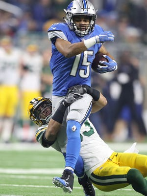 Lions receiver Golden Tate is tackled by Packers cornerback Damarious Randall during the second half of the Lions' 31-24 loss Jan. 1, 2017 at Ford Field.