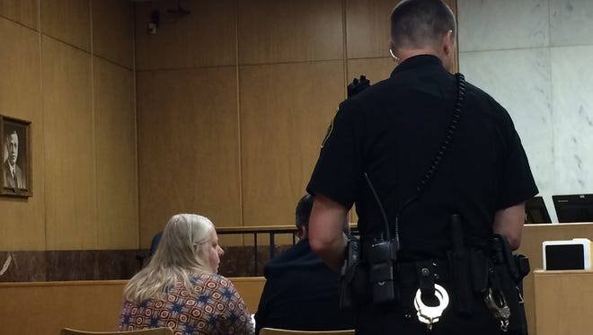 A deputy arrives to take Lorie Ann Miller, 55, of Rib Lake, to the Marathon County Jail after a judge sentenced Miller to a year in jail and five months probation Tuesday.