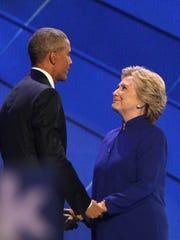 President Barack Obama and Democratic Presidential candidate Hillary Clinton are shown together after his speech at the Democratic National Convention in Philadelphia, PA, Wednesday, July 27, 2016.