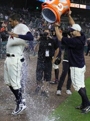 Detroit Tigers third baseman Jeimer Candelario gets drenched after his walk-off homer in the 12th inning for the 4-2 win over the Cleveland Indians on Saturday, June 9, 2018, at Comerica Park in Detroit.