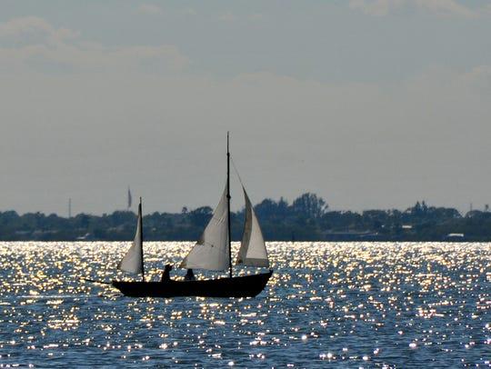 A sailboat sails on the Banana River.