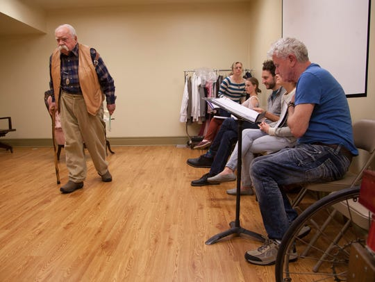 Members of The Stage Door theatre group rehearse Harvey
