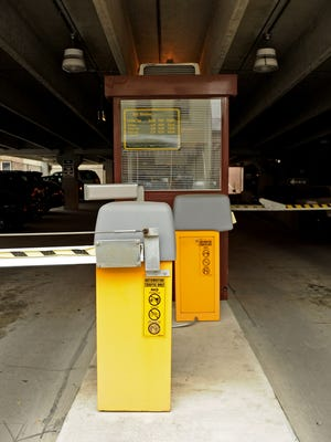 An automated ticket dispenser sits at the entrance of the New Street parking garage.
