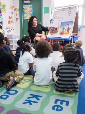 Kindergarten teacher Michelle Andersen reads to her class at C.A. Weis Elementary School in Pensacola on Thursday, December 1, 2016.