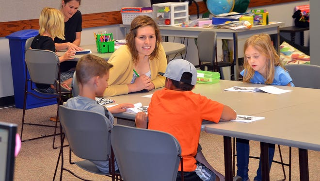 Katelyn Schmitt works with local students as part of her Masters of Education in Literacy work at Evangel University. She graduated from EU in 2015 and has taught second and third grade at Willard East Elementary. Background, Springfield schools first-grade teacher Kendall Shores works one-on-one with a student.