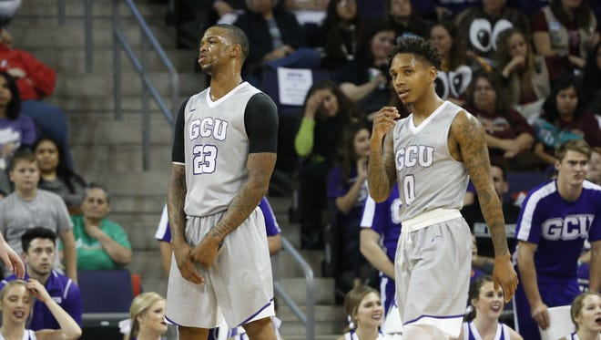 GCU's Darion Clark (23) and DeWayne Russell (0) react after a foul is called against Clark during the first half against Utah Valley at Grand Canyon University on January 7, 2017 in Phoenix, Ariz.