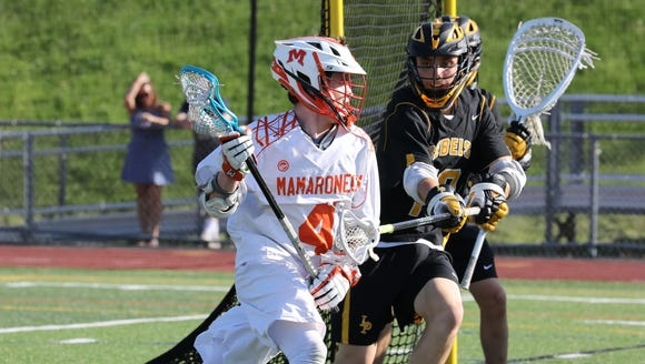 Mamaroneck's Tom Conley is pressured by Lakeland/Panas'
