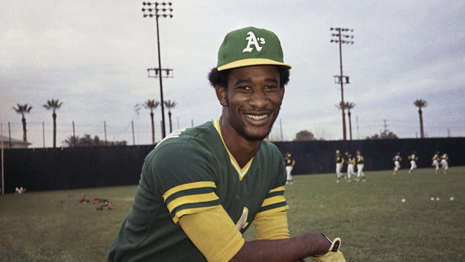 FILE - This 1975 file photo shows Oakland A's outfielder Claudell Washington. Washington, a two-time All-Star outfielder who played 17 seasons in the majors after being called up as a teenager in Oakland, died Wednesday, June 10, 2020. He was 65.