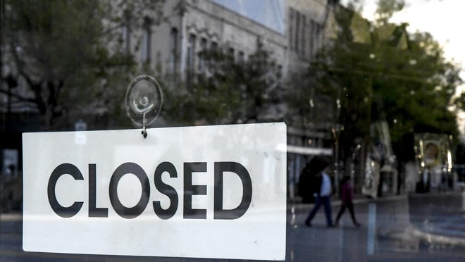 """A """"closed"""" sign is shown in a downtown Garden City business on May 4. The county is set to fully reopen on June 8."""