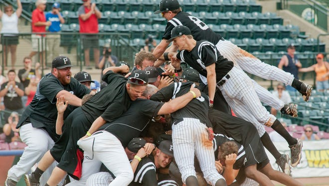 Pleasure Ridge Park players celebrate on the pitcher's mound moments after winning the KHSAA state baseball championship, defeating Simon Kenton (Independence, Ky.) 6-5.17 June 2017