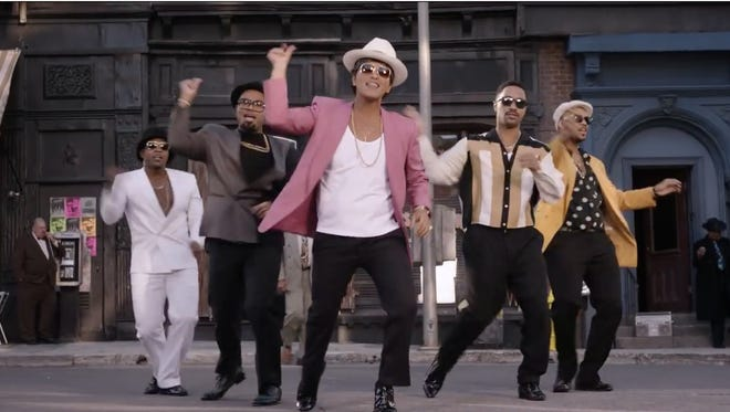 "This screenshot from Mark Ronson features Bruno Mars and the ""Uptown Funk"" video."