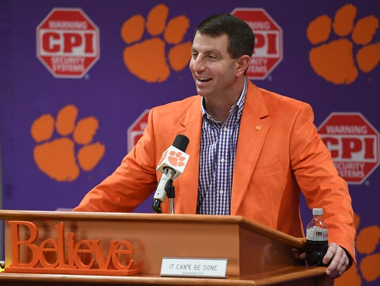 Clemson head coach Dabo Swinney talks with the media